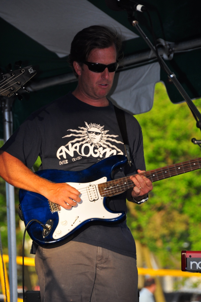 Peter Stuart, local rowayton realtor playing guitar with Assembly of DUST.